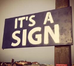 The road ahead is directed by signs.